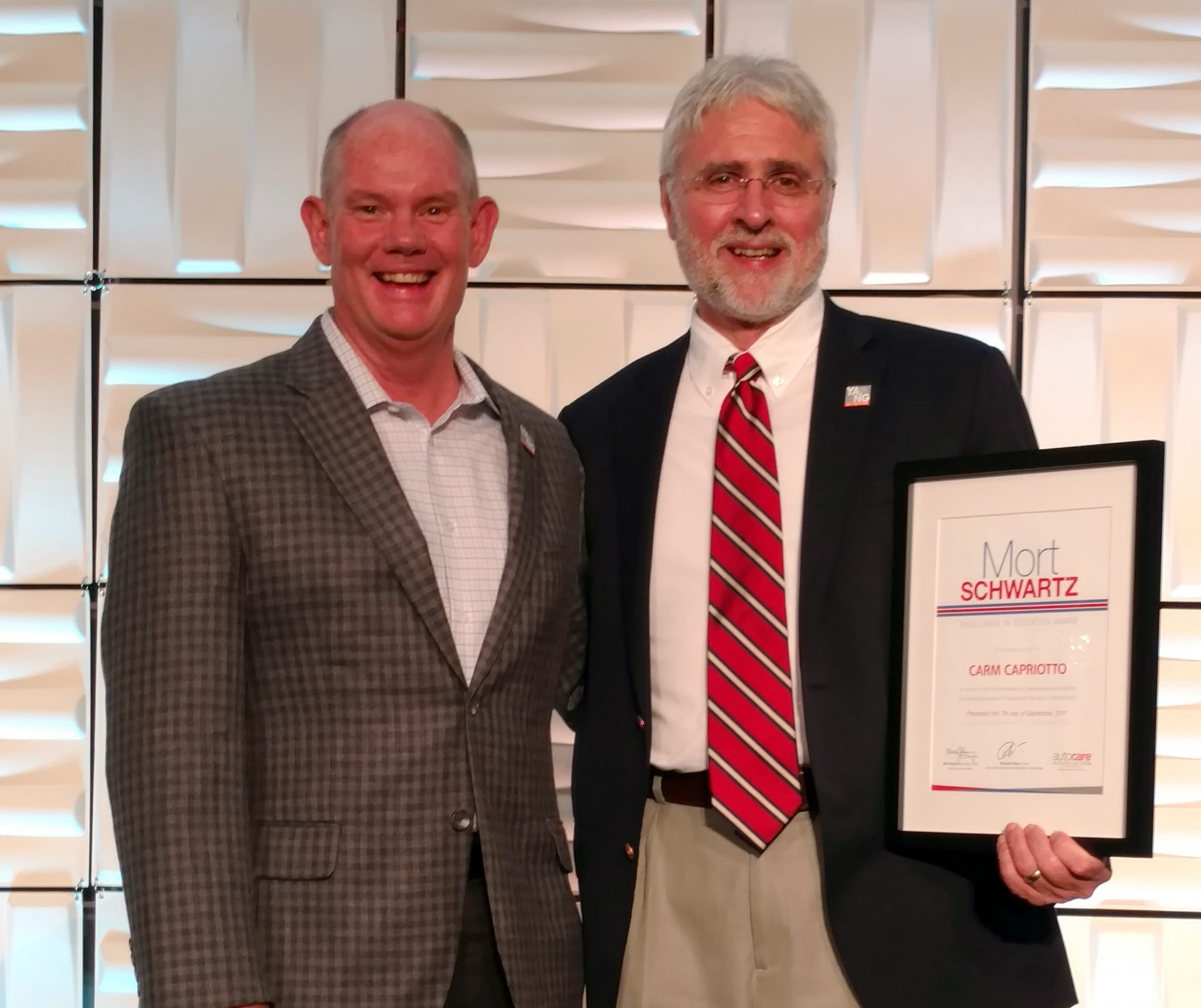 Bill Hanvey, Auto Care Association President and CEO presents Carm Capriotto the 2017 Mort Schwartz Excellence In Education Award In San Francisco at Fall Leadership Days in September 2017.